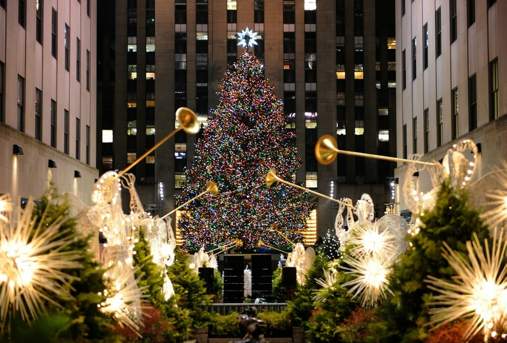The Rockefeller Center Christmas Tree is lit on November 30, 2010 in New York. Originally from Mahopac, New York, the 12-ton, 74-foot Norway Spruce is adorned with 30,000 environmentally friendly LED lights on more than five miles of electrical wire, and topped with a Swarovski crystal star. AFP PHOTO / Stan Honda (Photo credit should read STAN HONDA/AFP/Getty Images)